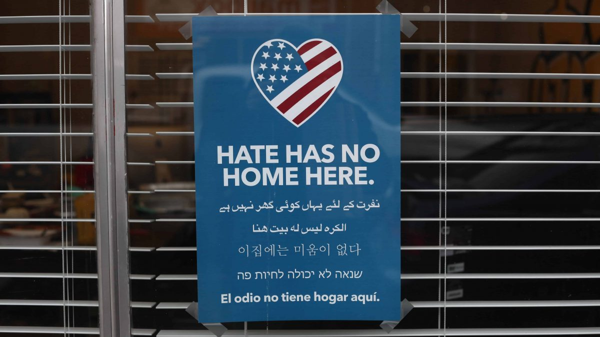 Sign Hanging In Business Denouncing Hate