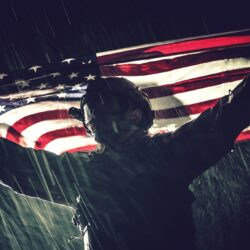 Proud American Army Soldier with National Flag in Hands During Heavy Thunderstorm and Rainfall. United States of America. Victory Concept. Military Theme.
