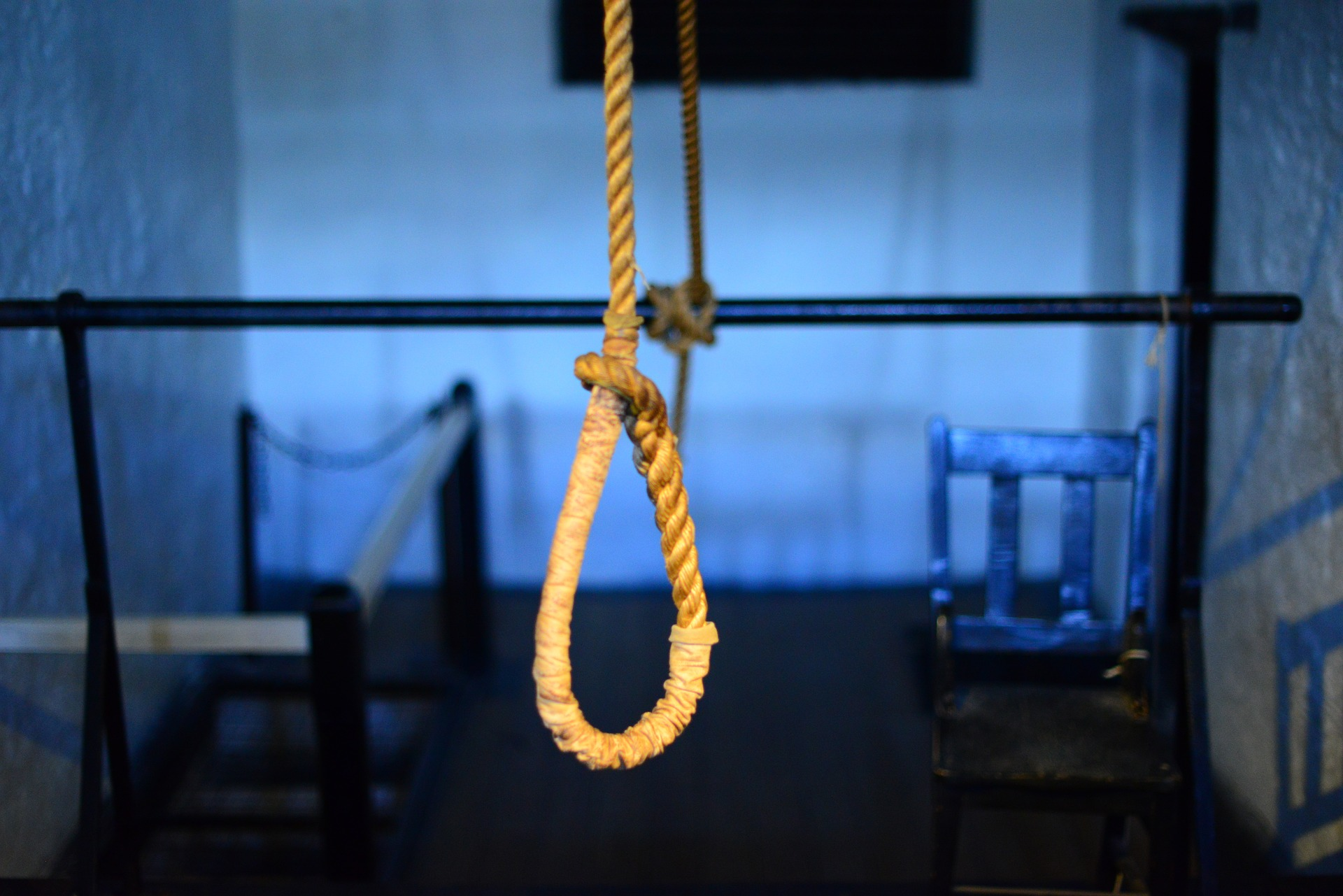 A noose hanging freely in a room